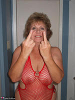 Busty Bliss. Red Fishnet Teddy Free Pic 9