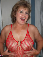 Busty Bliss. Red Fishnet Teddy Free Pic 11