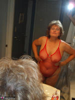 Busty Bliss. Red Fishnet Teddy Free Pic 15