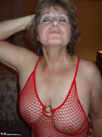 Busty Bliss. Red Fishnet Teddy Free Pic 17