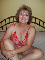 Busty Bliss. Red Fishnet Teddy Free Pic 19