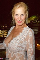 Molly MILF. On The Balcony At Night Free Pic 1