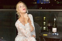 Molly MILF. On The Balcony At Night Free Pic 3