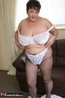 Kinky Carol. White Frilly Mini & Fishnets Pt1 Free Pic 17