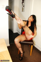Raunchy Raven. Raven Rips Her Pantyhose In A Red Hot Mini Skirt Pt2 Free Pic 2