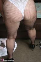 Kinky Carol. White Frilly Mini & Fishnets Pt2 Free Pic 7