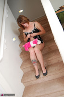 Misty B. stripping on the steps Free Pic 11