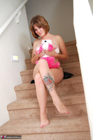 Misty B. stripping on the steps Free Pic 17