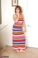 Misty B. Stripey dress striptease Free Pic 1