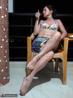 Diana Ananta. Smoking On The Balcony Free Pic 4