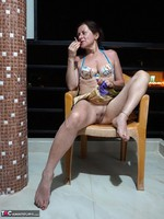 Diana Ananta. Smoking On The Balcony Free Pic 7