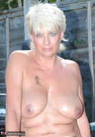 . Naked & Topless In The Garden Free Pic 2