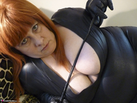 Mrs Leather. Big Tits On Bed Free Pic 1