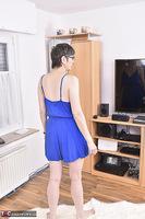 Hot Milf. Blue Dress On The Fur Rug Free Pic 1