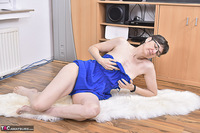 Hot Milf. Blue Dress On The Fur Rug Free Pic 8