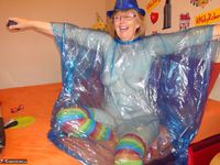 Abby Roberts. Posing In A Blue Transparent Raincoat Free Pic 12