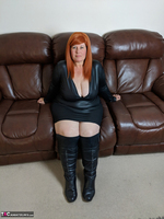 Mrs Leather. Leather Dress & Boots On The Sofa Free Pic 1