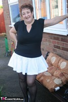 Kinky Carol. White Mini & Stockings Pt1 Free Pic 1