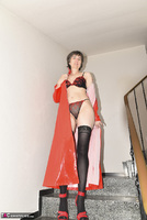 Hot Milf. Red Coat On The Stairs Free Pic 6