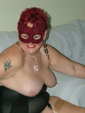 Considerable black corset Full length black corset and stockings, and a little red feather mask to top it all off.. Mature, milf, bbw/curvy, united kingdom, nylons, stockings, flashing, exhibitionist, gloves