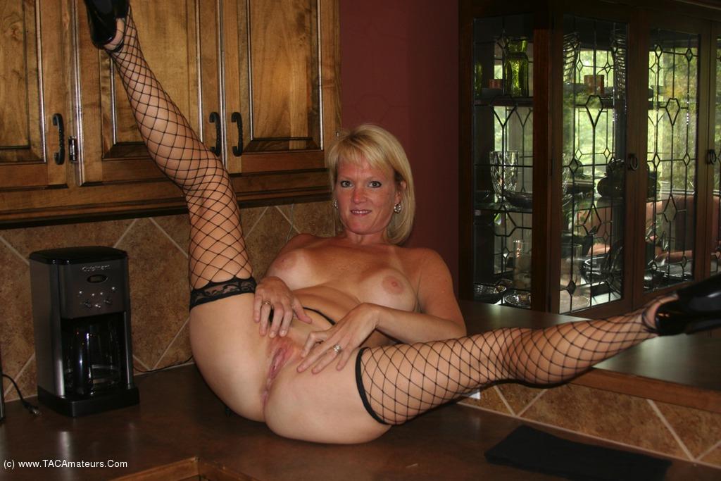 Busty mature undressing