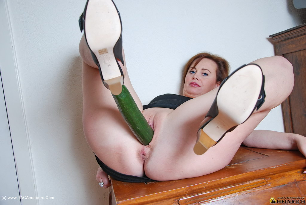 Milf inserting cucumber