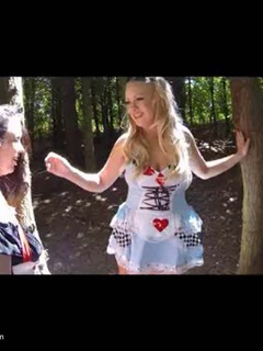 Alice and the Queen of Hearts take a walk through the woods and come across a rather sexy looking guy with the words