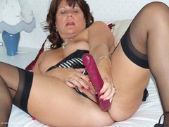 Sandy - Sheer black stockings and a huge dildo Gallery