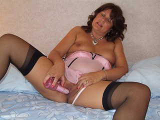 Sandy - Playing with my pink rabbit in sexy black stockings Picture Gallery