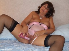 Sandy - Playing with my pink rabbit in sexy black stockings Photo Album
