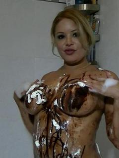 Loni Bunny home video volume 3, sexy voluptuous Latina model Loni taking a shower while covered with whipcream and choco