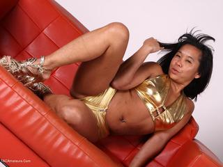 Asian Deepthroat - Melissas Gold Outfit Picture Gallery