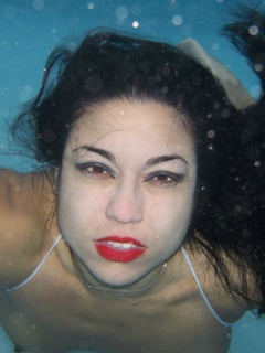 Ching Lan goes to the pool to do some swimming. She loves to video tape herself getting naked under water in the public