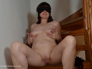 Hot Milf - Posing On The Stairs Picture Gallery