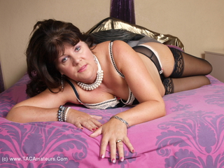 Sandy - On The Bed Picture Gallery