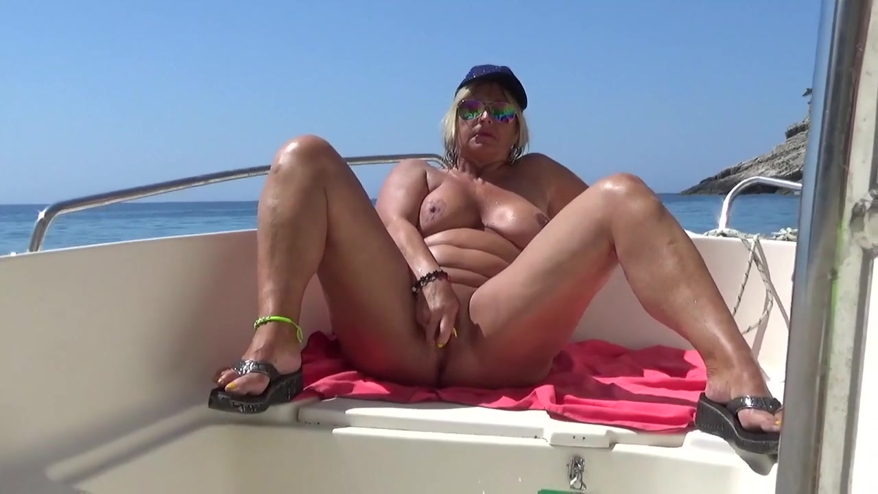 Woman sits on a boat and enjoys the blue caves of zakynthos island ionian sea greece stock photo