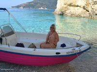 Each time I am in Greece, I try to rent a boat. When I have left the beach, I put my bikini off. So I get the sun all ov