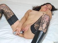 Kimberley, Filipino porn model nude and masturbating with small vibrator.
