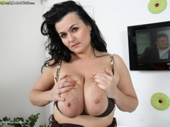 BustyReny - Big boobs on white table Gallery
