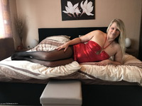 My hot red dress and black nylons. Can I go to the Bar