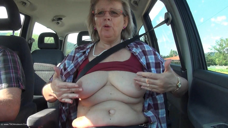AbbyRoberts - Natural boobs in the car.  scene 0