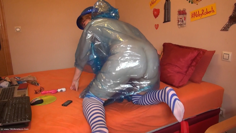 AbbyRoberts - Posing In A Blue Transparent Raincoat scene 3