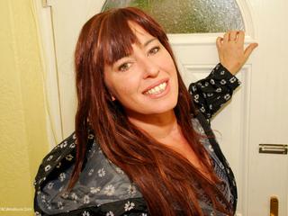 Juicey Janey - Rain Mac Striptease Pt1 Picture Gallery