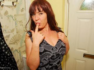Juicey Janey - Rain Mac Striptease Pt2 Picture Gallery
