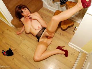 Juicey Janey - Rain Mac Striptease Pt4 Picture Gallery