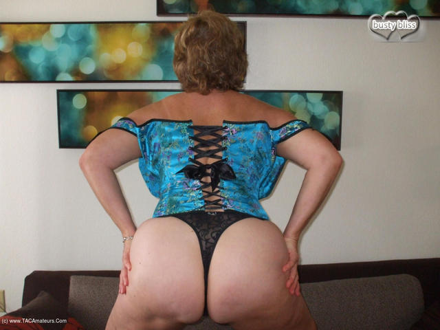 BustyBliss - Teal Corset Showing Off That Arse