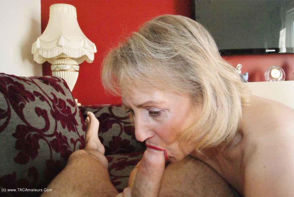 Lady mature stripping
